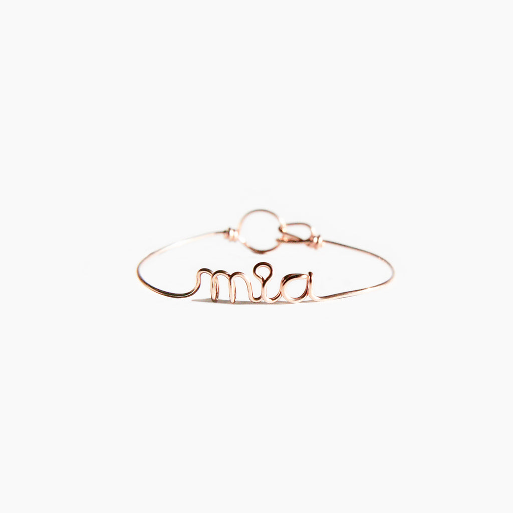 Personalised Mia name wire bangle bracelet in Rose Gold handmade by Rachel and Joseph jewellery UK