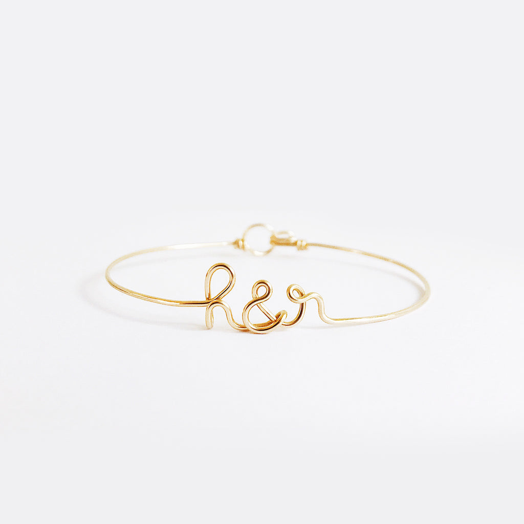 Personalised Initials with ampersand h&r wire bangle bracelet in Yellow Gold handmade by Rachel and Joseph Jewellery UK