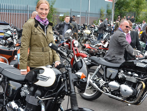 stylish lady with triumph dressed in tweed