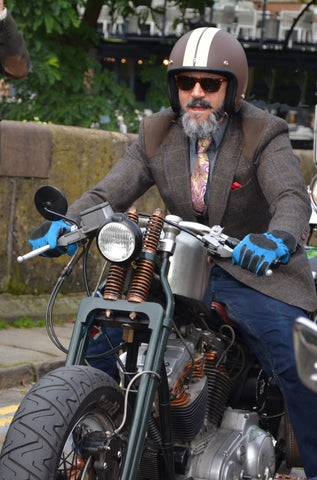 The beard, the attitude, the mean bike, the sky blue gloves..?