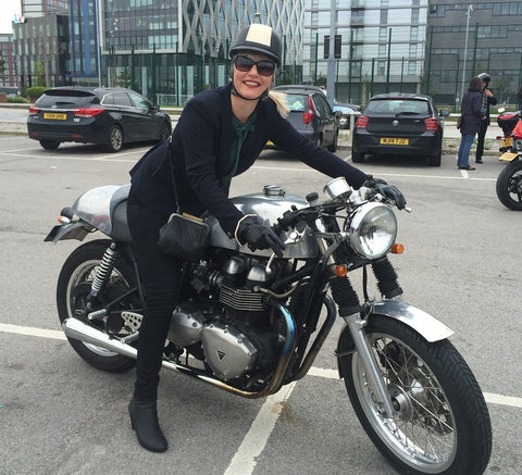 very stylish lady aboard triumph cafe racer Manchester gentlemans ride