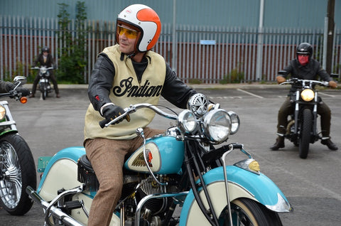 Distinguished gentlemans rider on a blue & white Indian with Indian pullover