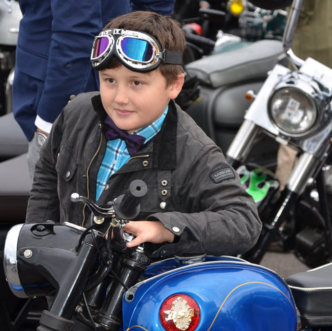 young boy in aviator goggles on a BSA Manchester Gentlemans Ride