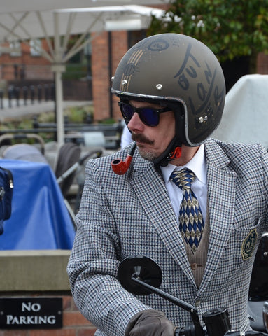 Distinguished gentlemans rider smoking a pipe