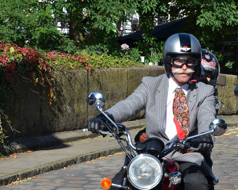 gentlemans ride dapper chapper with big mustache