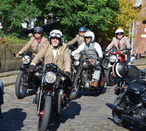 Motoguzzis arriving at Dukes 92 V7 and cafe racer Distinguished Gentlemans Ride