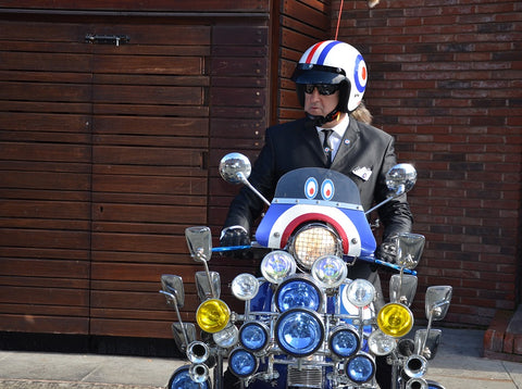 stylish gent on a lambretta bedecked with mirrors at Manchester Gentlemans Ride