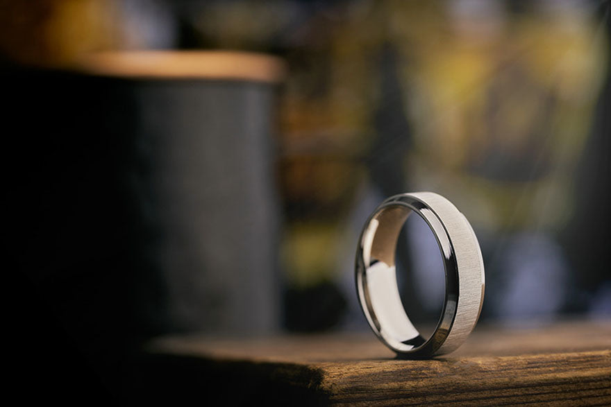 the ruler ring sitting on its side on top of a table