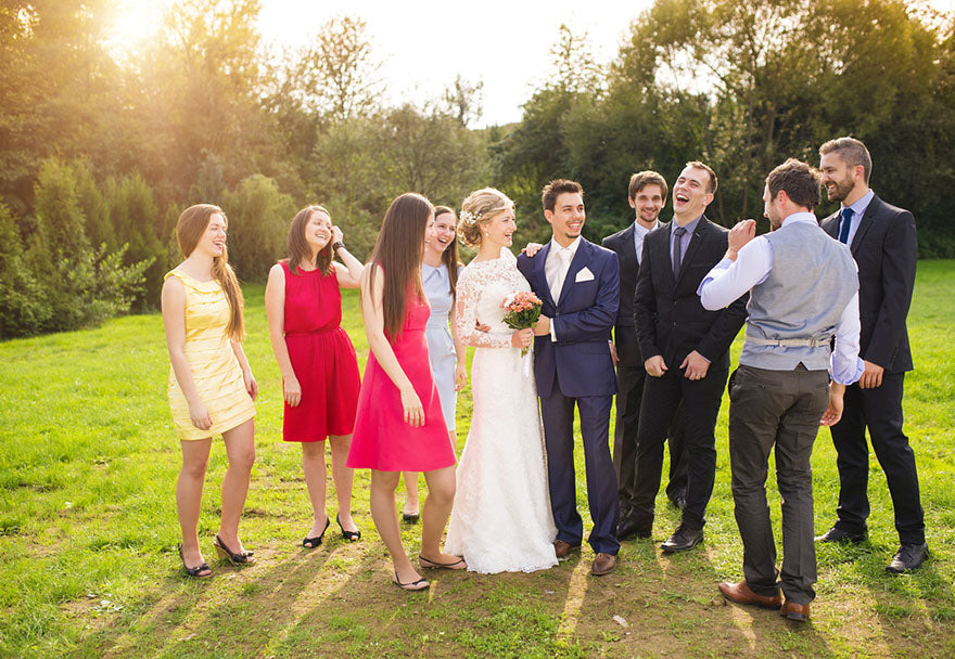 a bride and groom with their wedding party