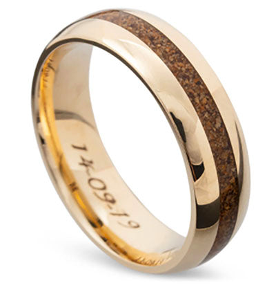 a gold engraved wedding band