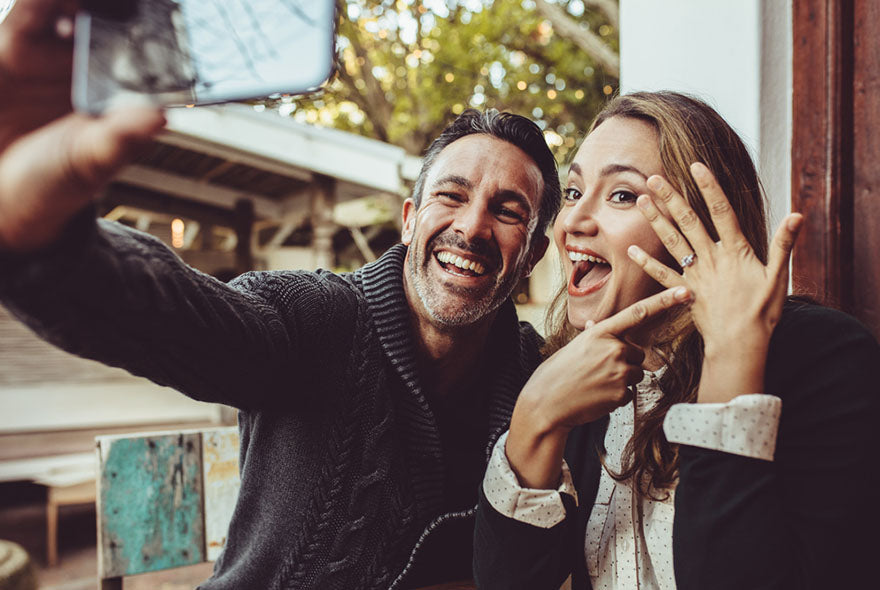 just engaged couple taking selfie