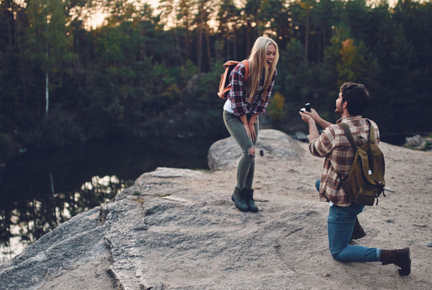 man proposing on scenic cliff