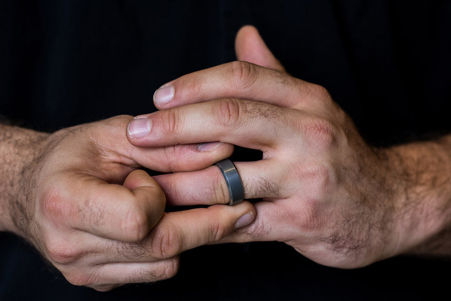 mans hands fidgeting with wedding ring