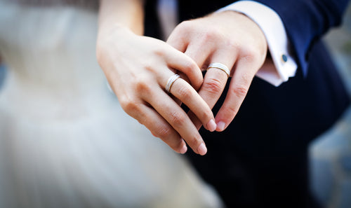 newly wed couples hands