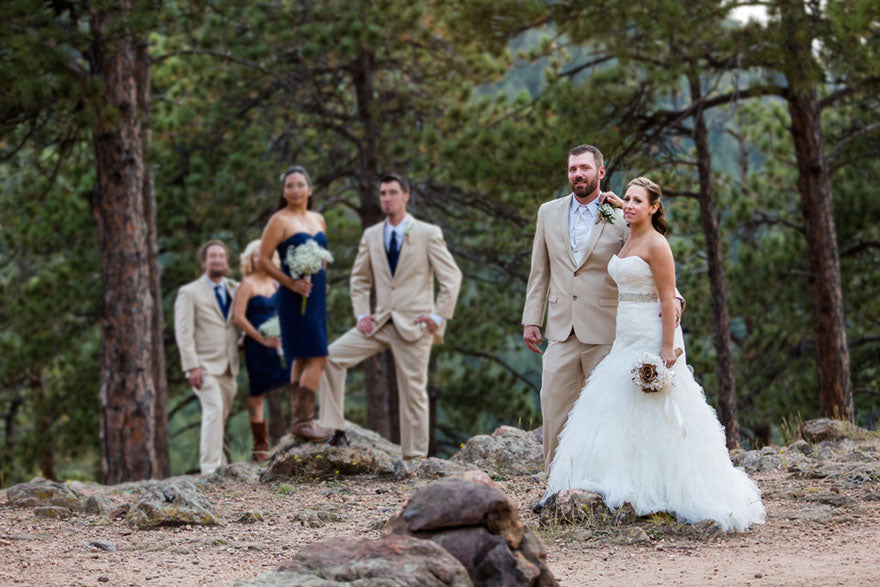 small wedding party posing outdoors