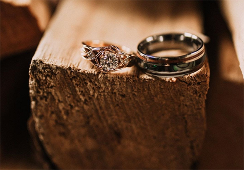 wedding bands on wood