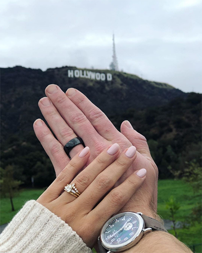 wedding rings hands with hollywood background