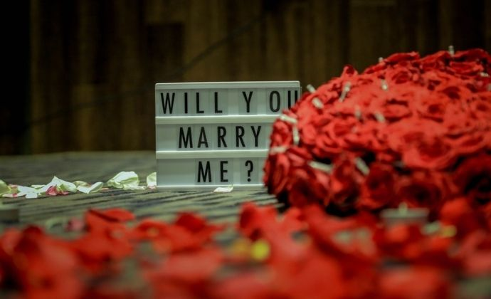 propose a girl with rose petals