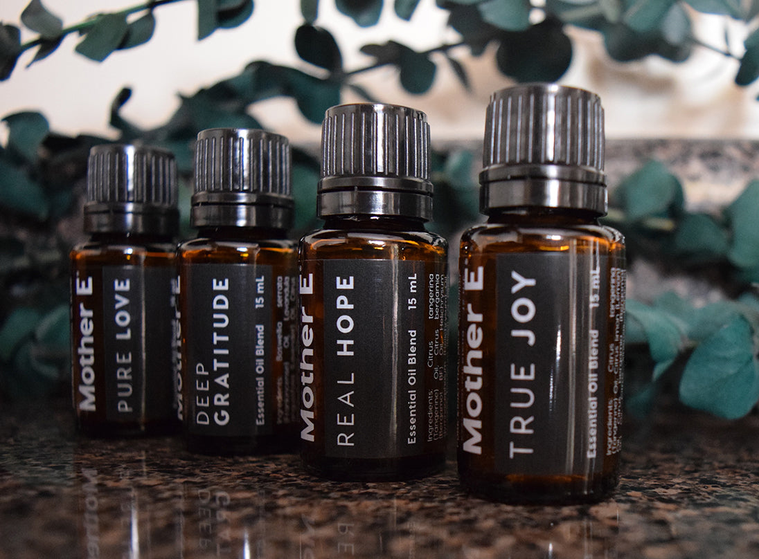 The Enhancer Oils, Pure Love, Deep Gratitude, Real Hope and True Joy, on a Kitchen Counter