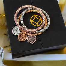 Load image into Gallery viewer, 3 Sets of Holiday Gift Wrap - Magic in a Box Tree of Life Heart Edition Charm Bracelets