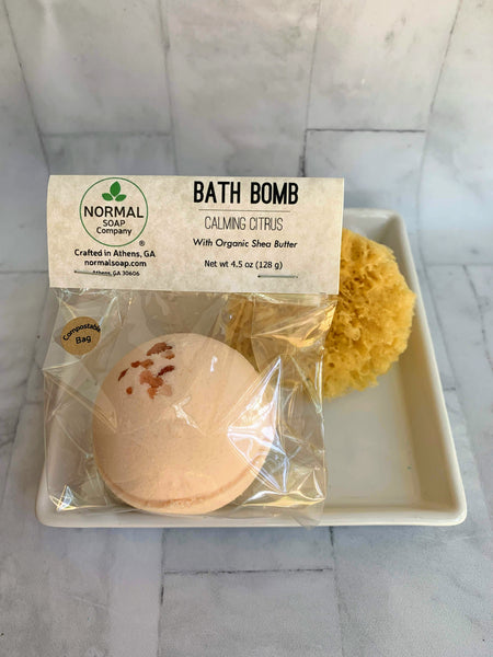 Calming Citrus Bath Bomb with Organic Shea Butter and essential oils. Compostable packaging
