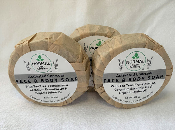 Activated Charcoal Face Soap featuring Tea Tree & Geranium Essential Oil; Camellia Seed and Organic Jojoba Oil