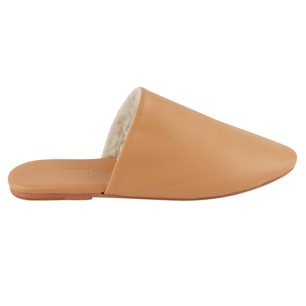Tan sheepskin leather closed-toe shoe, mule with open back.