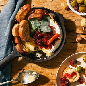 Cast Iron-Baked Brie with Cranberry and Savory