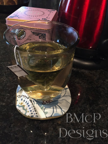 Footed glass coaster on a tea cup
