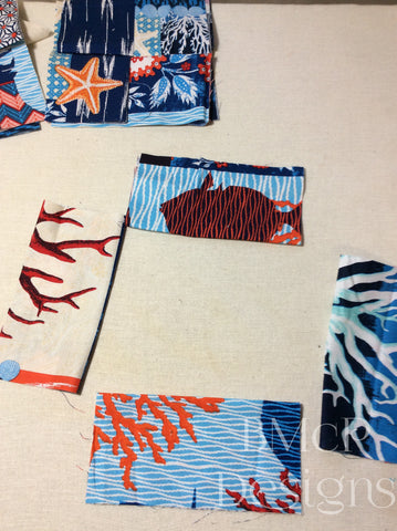 Fabric squares folded and pressed in half