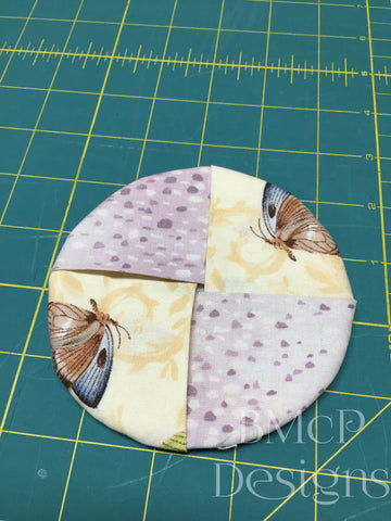 Footed glass coaster in circle with butterfly fabric