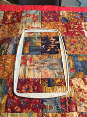 Stick the top hoop on the quilt sandwich where you would like the design to be stitched