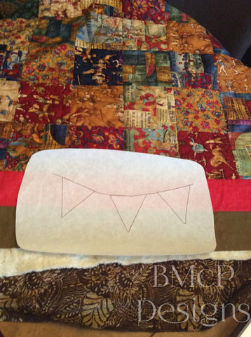 image of stiched out bunting design for in the hoop quilting