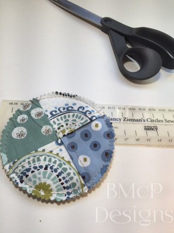 Footed glass coaster after it has been sewn with Nancy Zieman's Circles Sew Simple Tool