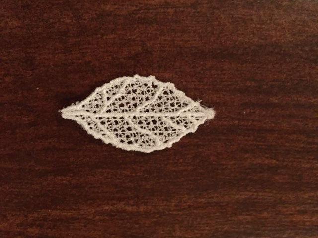 Embroidered lace leaf