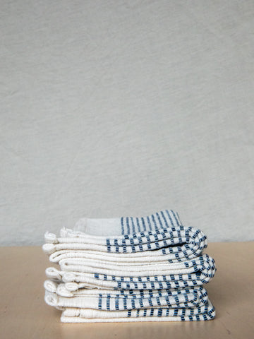 Riviera Napkin in Natural with Navy