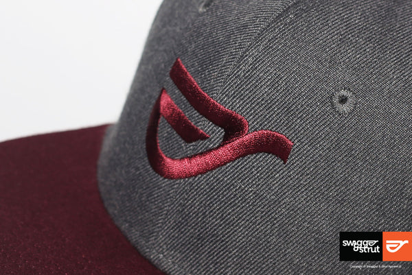 Burgundy Embroidered Logo on our Dark Grey Snapback