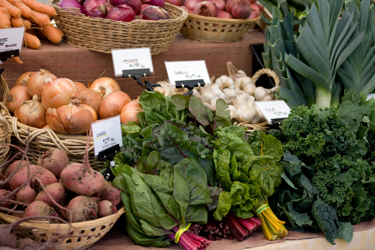 farmers market leafy greens and root veggies