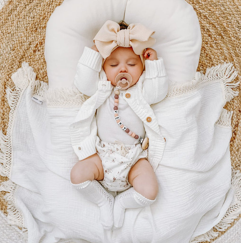 CREAM SWADDLE WITH NATURAL FRINGE