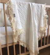 Cream double gauze swaddle with natural fringe