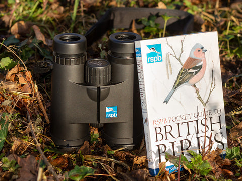 Binoculars and bird book