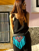 Bag Of Hope BOH blue tassel multicolour embroidered waist bag leather shoulder bag on model