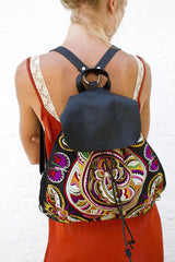 Snake Swirl BOH embroidered leather backpack handbag close up model