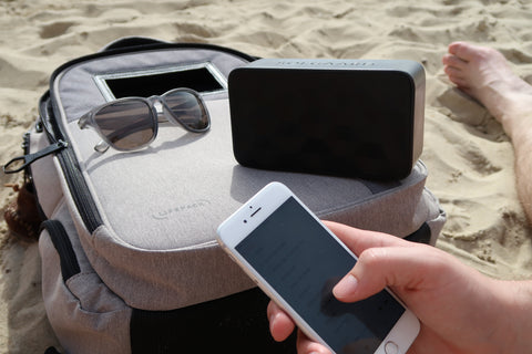 Solarbank playing music, iPhone fully charged, Lifepack in the sand camping