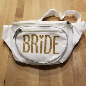 White three pocket Bride women's fanny packs with gold glitter vinyl lettering