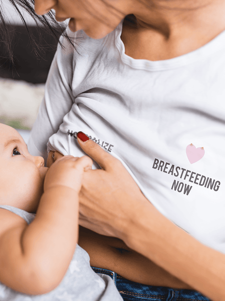 Let the world know where you stand with our Normalize Breastfeeding Now lady's Tri-Blend fitted t-shirt! White with dark grey type and our heart with a twist. #NormalizeBreastfeedingNow. Proceeds from the shirt will go to NormalizeBreastfeeding.org.