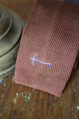 Flat knit tie with logo embroidery