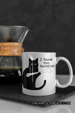 I found this humerus mug or shirt available 15 oz.  Humerus cat
