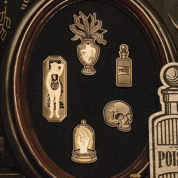 The Curio Enamel Pin set