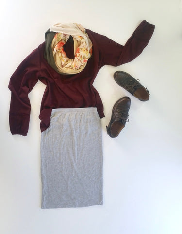 flat lay: wine colored, flowy blouse, gray, jersey skirt, brown oxfords, and a floral Regenerous Designs scarf